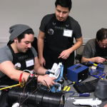 Fixers working on small appliances